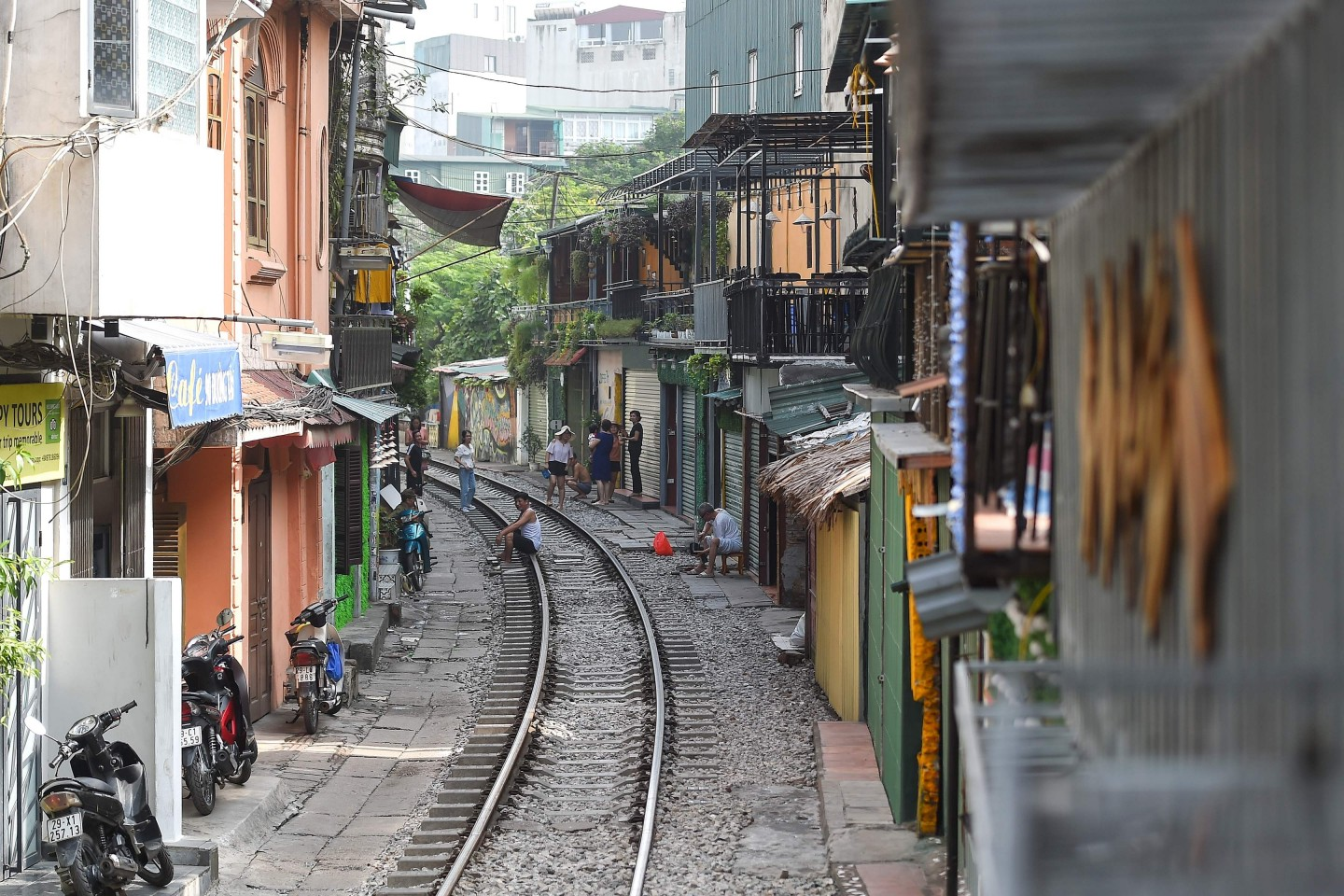 "Vietnam has a seemingly insatiable appetite for domestic infrastructure investment. A resident sits on Hanoi's popular train street on October 10, 2019 following a municipal authorities order to deal with cafes and ""ensure safety"" on the railway track. (Photo by Nhac NGUYEN / AFP)"