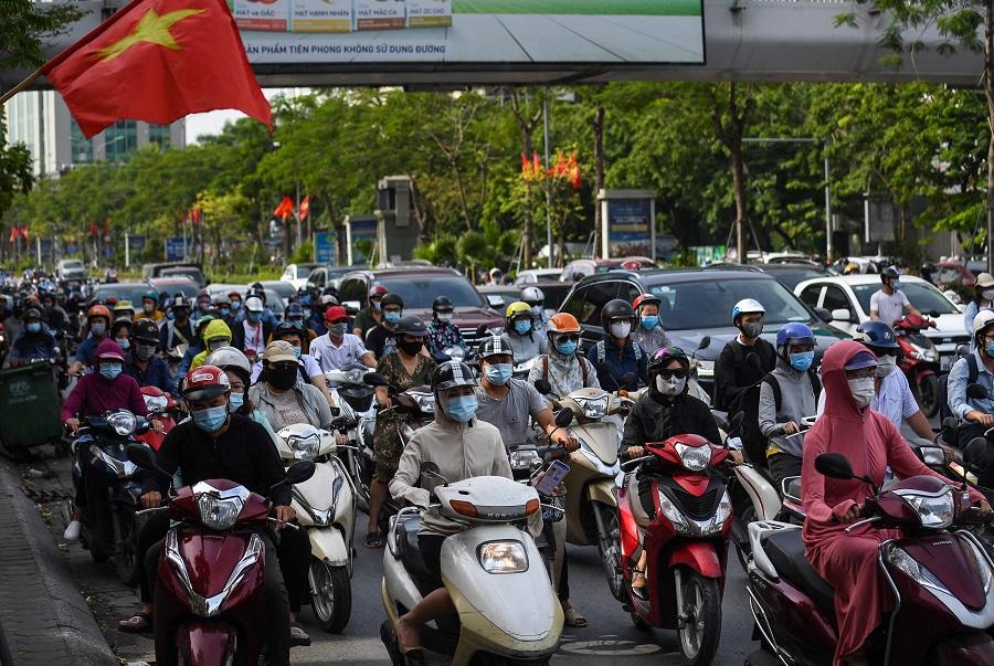 Motorists travel along a road in Hanoi, Vietnam on 2 June 2021. (Nhac Nguyen/AFP)