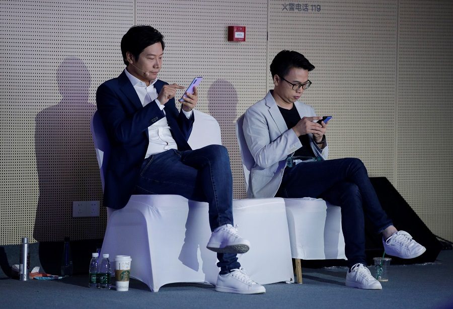 Xiaomi founder Xiaomi founder and CEO Lei Jun (L) at launch event of Xiaomi Mi9 Pro 5G and Mi MIX Alpha concept smartphone in Beijing