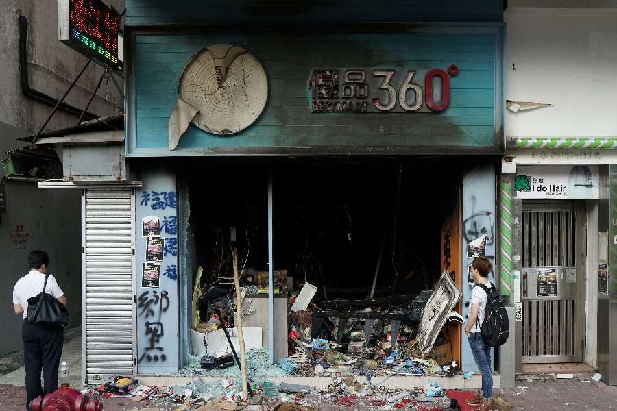 A vandalised Best Mart is seen during Sunday's anti-government protest in Hong Kong on 21 October 2019. Best Mart is perceived to be pro-Beijing by protestors. (Umit Bektas/Reuters)