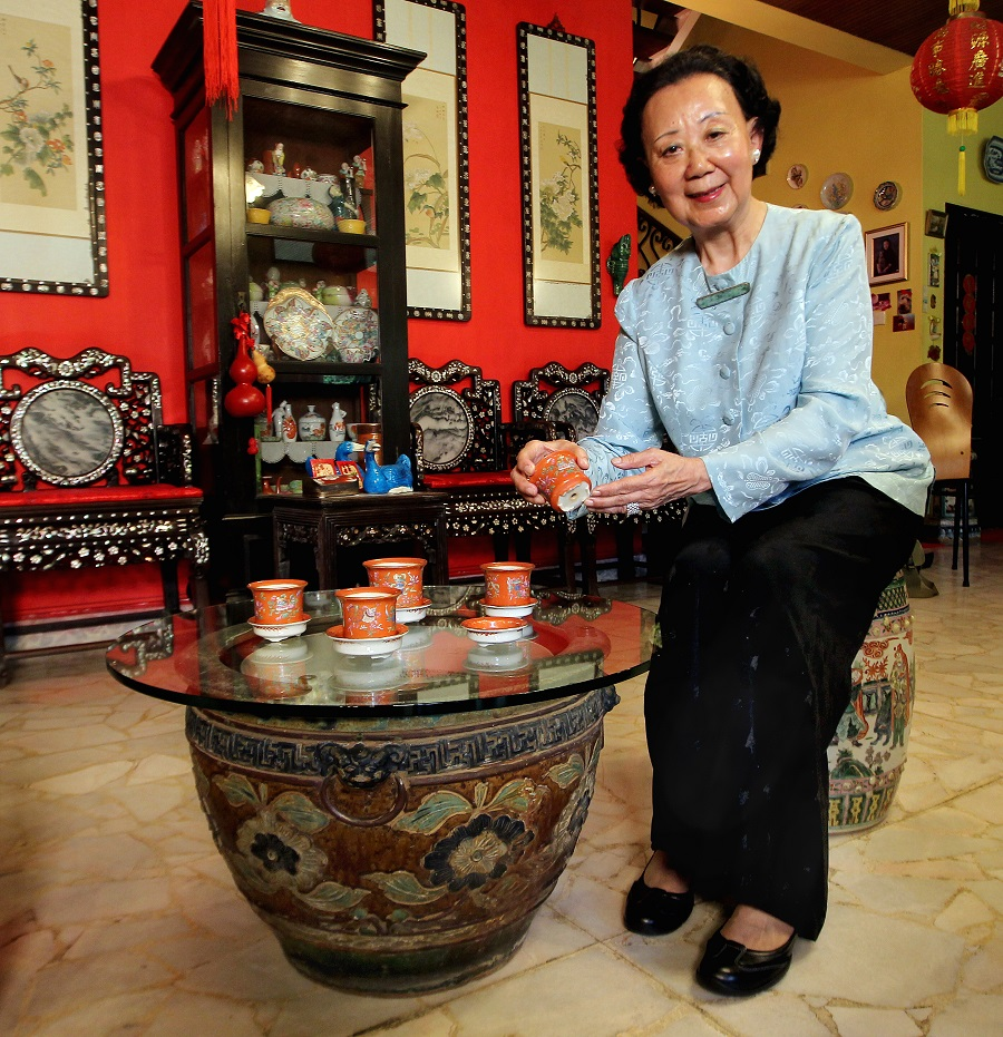 Madam Hoo Miew Oon, great-granddaughter of Hoo Ah Kay, better known as Whampoa, with some of the pots she has donated to the Singapore Botanic Gardens heritage museum. The old pots will take pride of place at the museum as they are cultural and historical artefacts that speak of Singapore's unique history. (SPH)