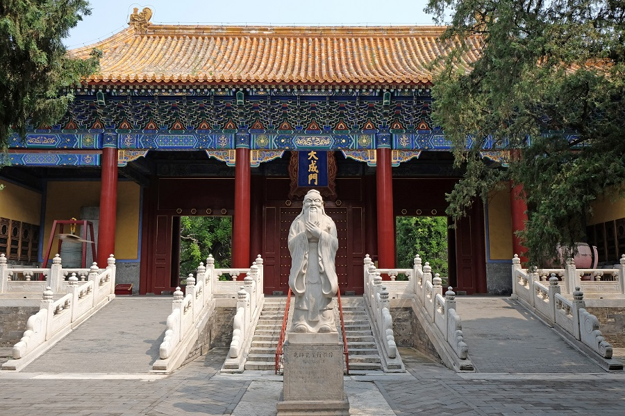 The statue of Confucius stands in front of the gate of Confucius Temple in Beijing, China. (iStock)