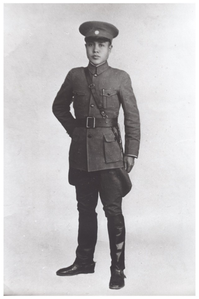 Father in full military uniform.