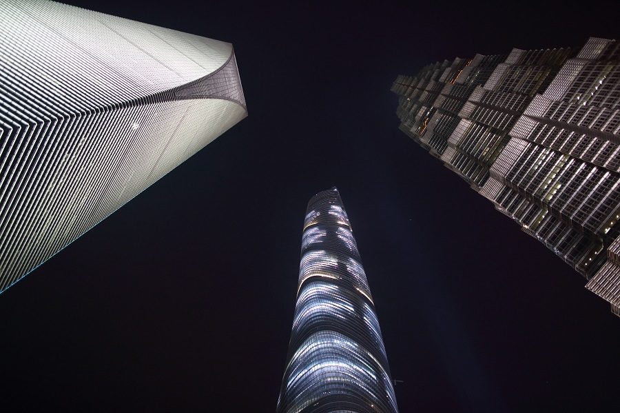 The Shanghai World Financial Center (left), the Shanghai Tower (centre), and the Jin Mao Tower stand illuminated at night in the Lujiazui district of Shanghai, China, 25 April 2015. (Tomohiro Ohsumi/Bloomberg)