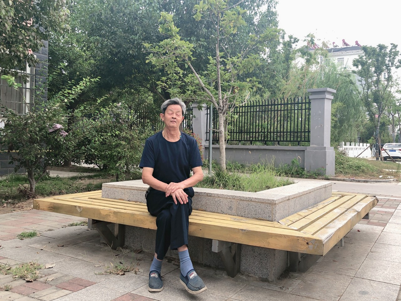 Tang Jinglin photographed at the Zhonglou Housing Estate in the county city of Fengyang, Anhui. He and his wife moved into a public rental unit here in 2013. (Photo: Tang Jinglin)