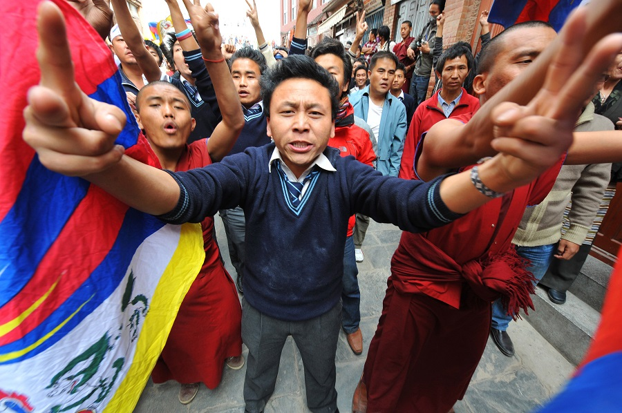 Tibetans protesting on the streets of Nepal's capital, Kathmandu on 10 March 2009. They were marking the 50th anniversary of a failed uprising against China, which led to Dalai Lama, the Tibetan spiritual leader, fleeing into exile. (Photo: Chong Jun Liang)