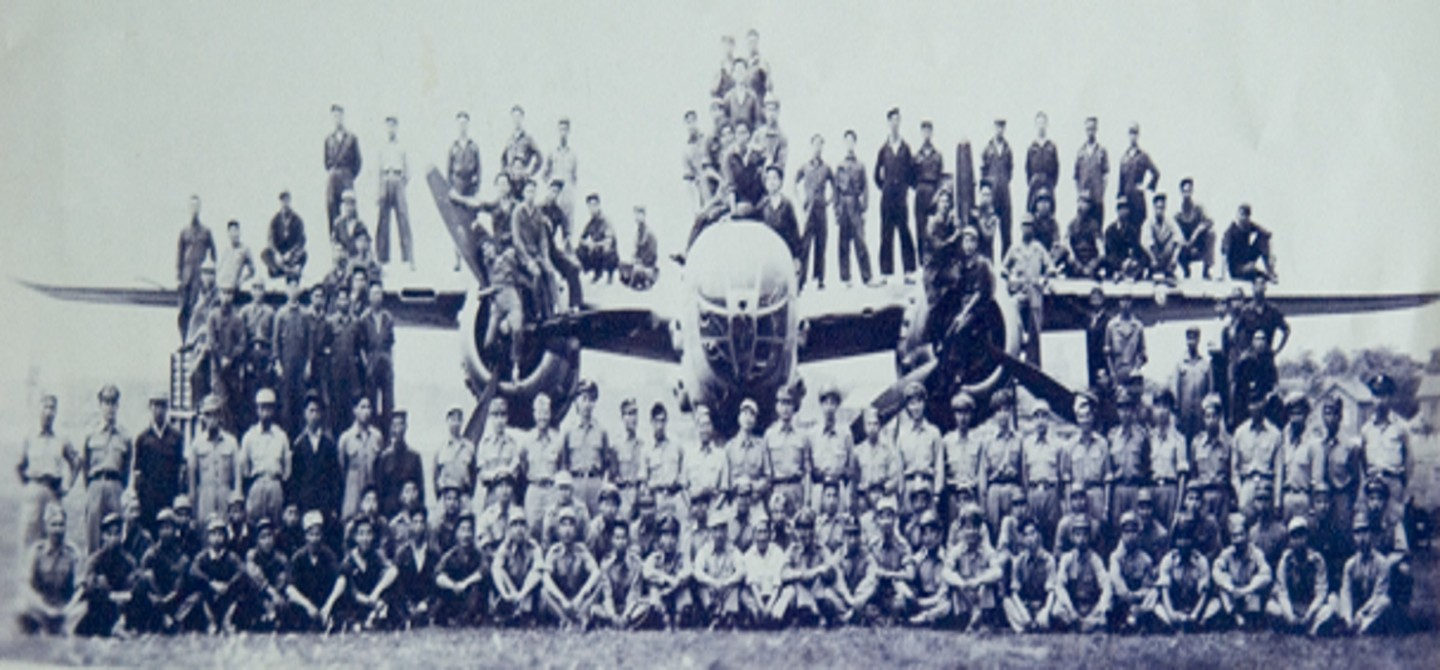 The entire 1st Bomb Squadron celebrating the Japanese surrender, Hanchung, 1945