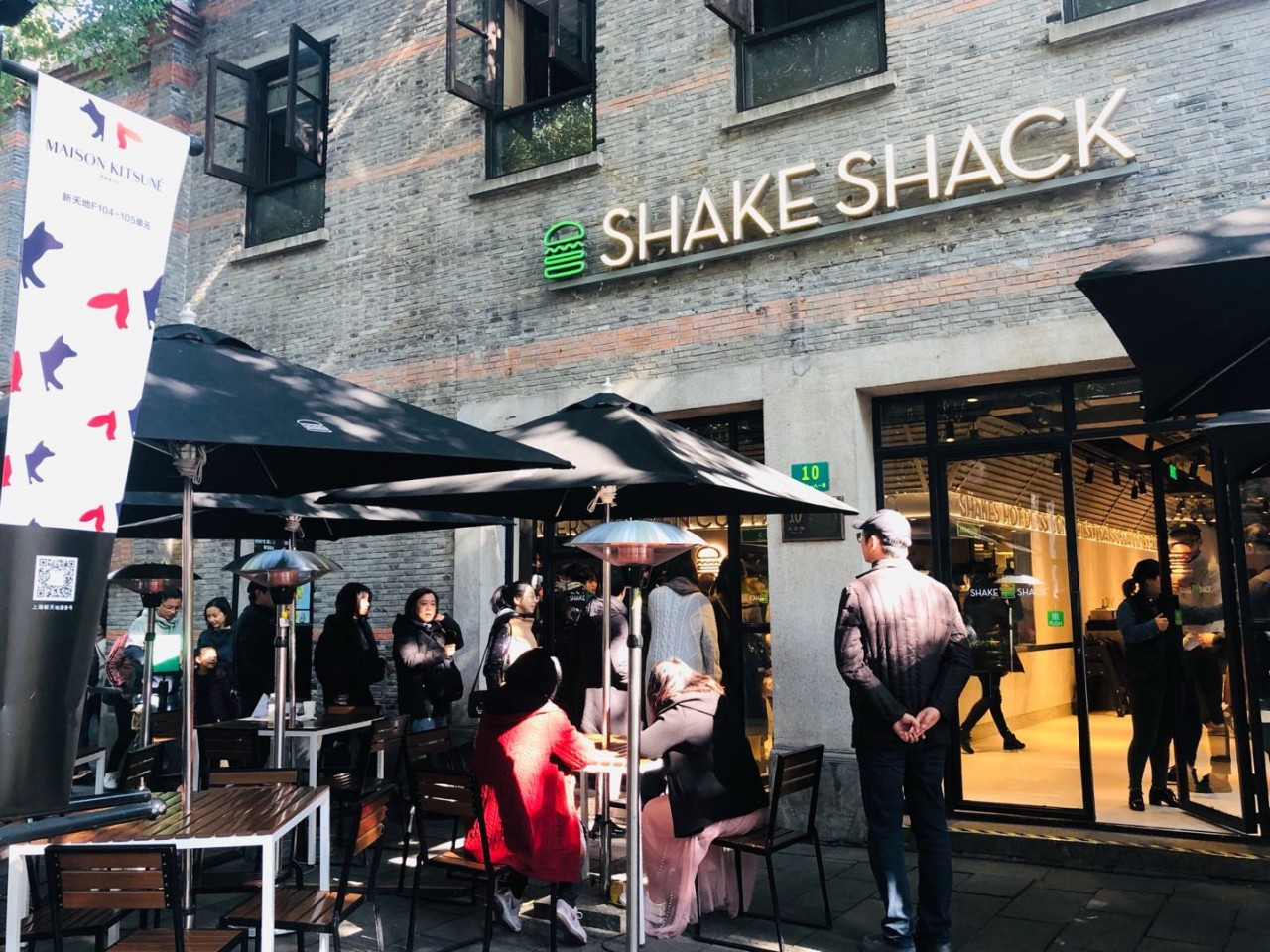 Queues form outside Shake Shack's first store in Shanghai.