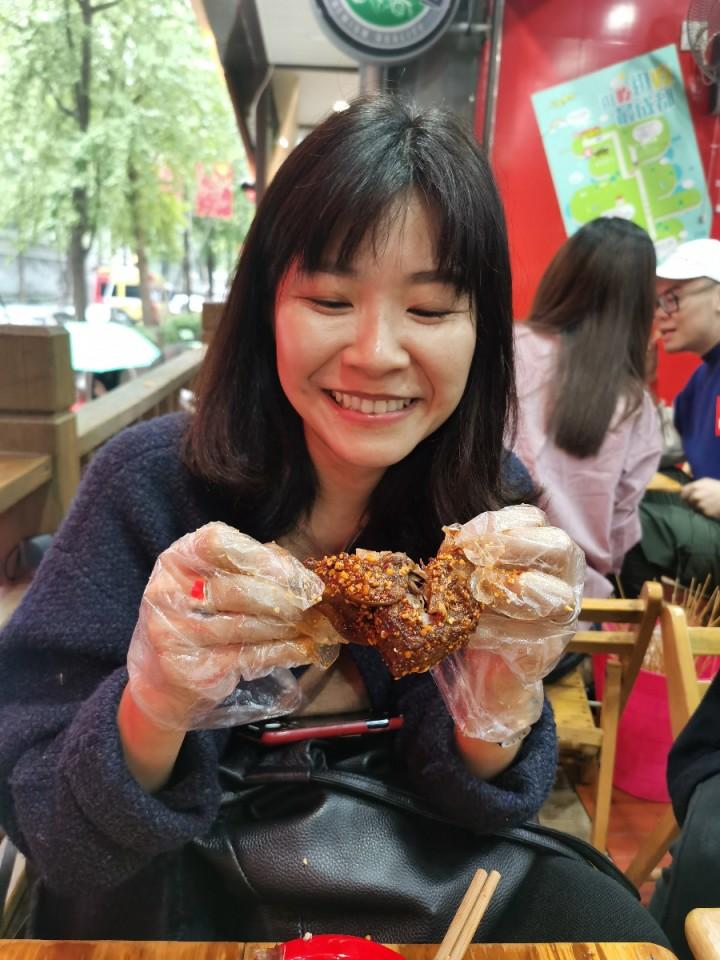 Tzu-i devouring a rabbit's head like a pro. (Photo: Tzu-i Chuang Mullinax)