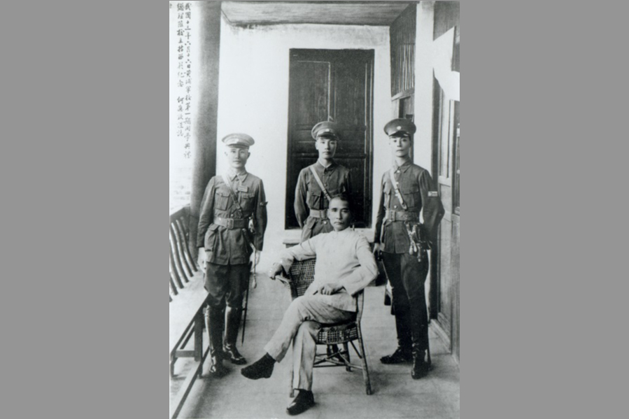 Sun Yat-sen (seated) at the opening ceremony of Whampoa Military Academy on 16 June 1924. Standing, from left: He Ying-qin, Chiang Kai-shek, Wang Bo-ling. (Wikimedia)