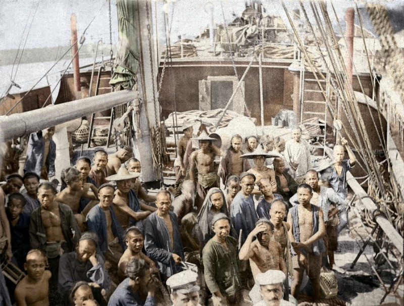 A boat arriving in Singapore with coolies, circa 1900. The coolies step out of the hold and stand on deck for a photograph taken by the German boat owner. This is a rare and valuable image because there are generally no photographs of early Chinese coolies. Coloured using modern image-processing technology, the photograph takes us right back to that boat deck a century ago, giving us a hint of how these coolies must have looked and felt upon arriving at their destination.