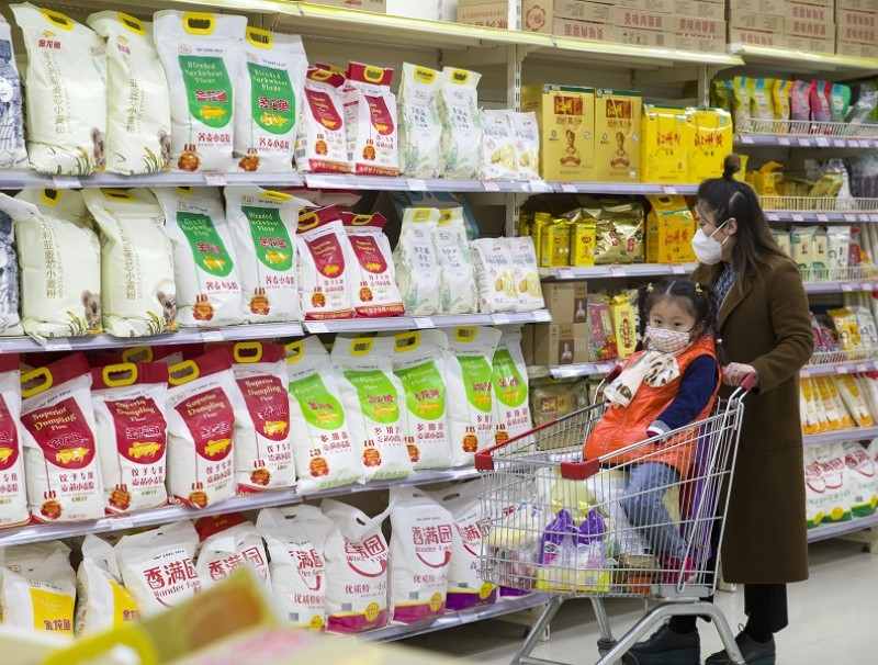 In this file photo, a consumer is choosing flour at a supermarket in Taiyuan city, Shanxi province, China. Chinese officials have repeatedly reassured the Chinese people that food supplies are sufficient and there is no need to hoard. (CNS)