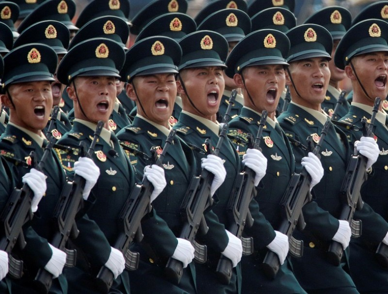 Soldiers of the People's Liberation Army (PLA) march in formation past Tiananmen Square during the military parade marking the 70th founding anniversary of the People's Republic of China, in Beijing, China, on 1 October 2019. (Jason Lee/File Photo/Reuters)