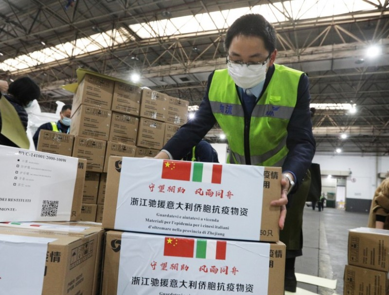 Staff members move medical supplies to be sent to Italy, at a logistics center of the international airport in Hangzhou, March 10, 2020. (China Daily via REUTERS)