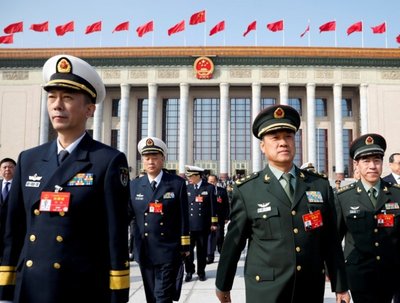 Military delegates leave the Great Hall of the People after a meeting ahead of National People's Congress (NPC), China's annual session of parliament, in Beijing, 4 March 2019. (Aly Song/REUTERS)