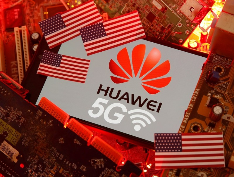 The US flag and a smartphone with the Huawei and 5G network logo are seen on a PC motherboard in this illustration taken on 29 January 2020. (Dado Ruvic/Illustration/File Photo/Reuters)