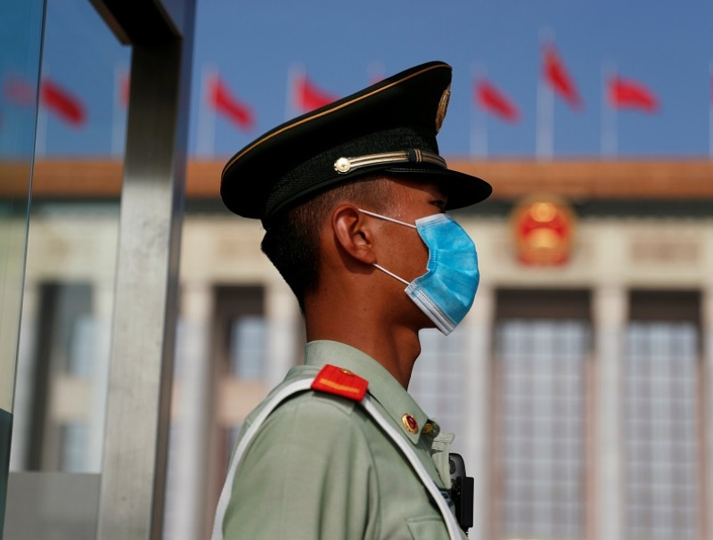 A paramilitary police officer wearing a face mask following the Covid-19 outbreak, stands guard outside the Great Hall of the People before the opening session of the National People's Congress (NPC) in Beijing, China, on 22 May 2020. (Carlos Garcia Rawlins/Reuters)