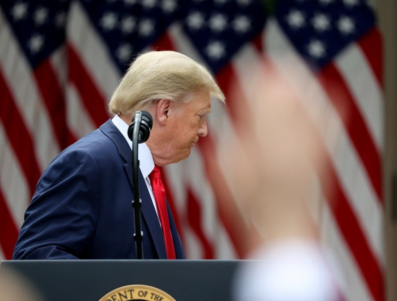 US President Donald Trump turns away and departs as reporters try to ask questions after the president made an announcement about US trade relations with China and Hong Kong in the Rose Garden of the White House in Washington, US, on 29 May 2020. (Jonathan Ernst/Reuters)