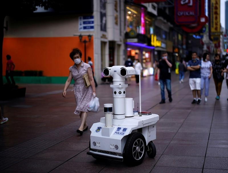 A police robot keeps watch on a shopping street in Shanghai, following the Covid-19 outbreak, on 16 June 2020. (Aly Song/Reuters)