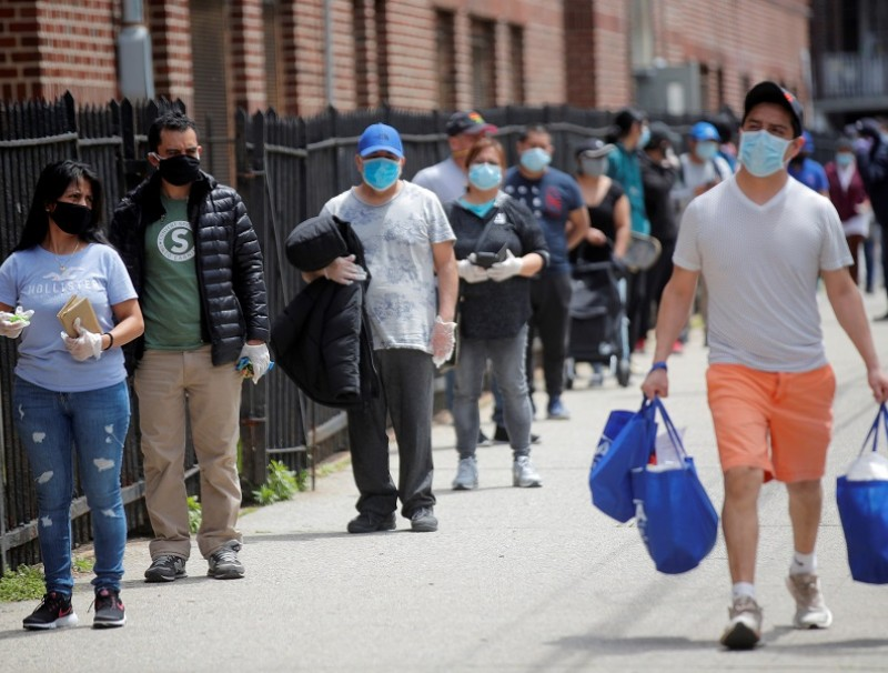 People wait in line at a food bank at St. Bartholomew Church in the Elmhurst section of Queens, New York City, New York, US, on 15 May 2020. (Brendan McDermid/File Photo/Reuters)