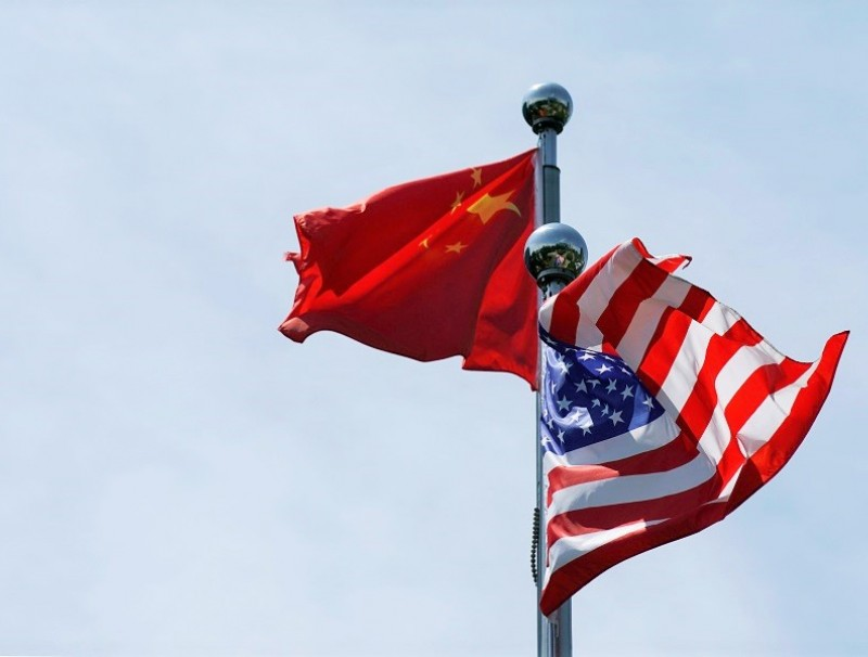 Chinese and US flags flutter before a trade meeting in Shanghai, China, 30 July 2019. (Aly Song/File Photo/Reuters)