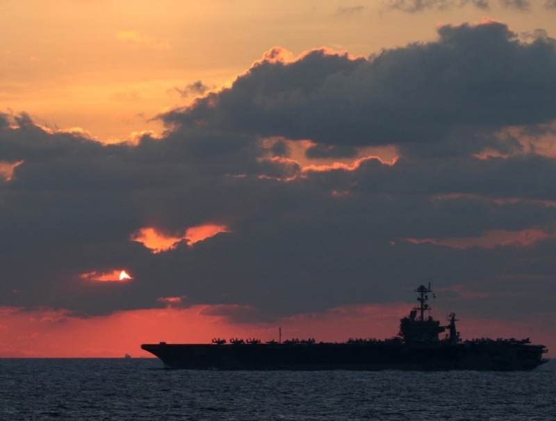 The U.S. Navy aircraft carrier USS John C. Stennis transits the South China Sea at sunset, 25 February 2019. (US Navy/Mass Communication Specialist 1st Class Ryan D. McLearnon/Handout via REUTERS)