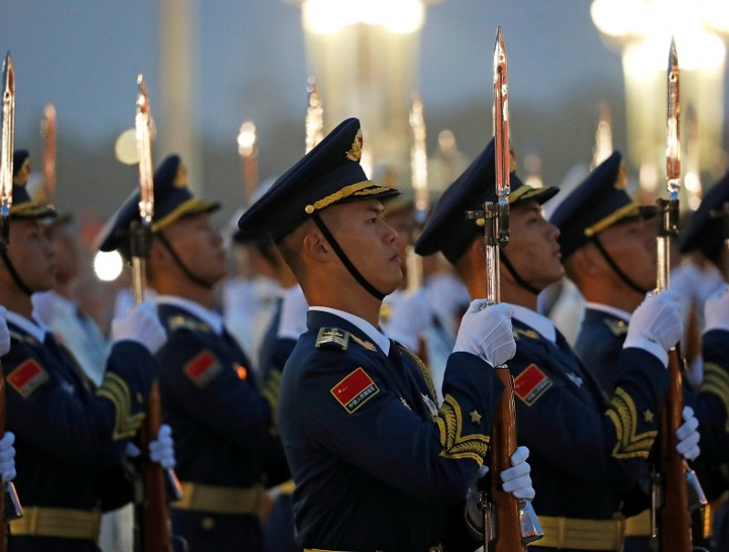 Members of the PLA Honour Guard attend a flag-raising ceremony at Tiananmen Square on National Day to mark the 71st anniversary of the founding of People's Republic of China, in Beijing, China, 1 October 2020. (Carlos Garcia Rawlins/Reuters)