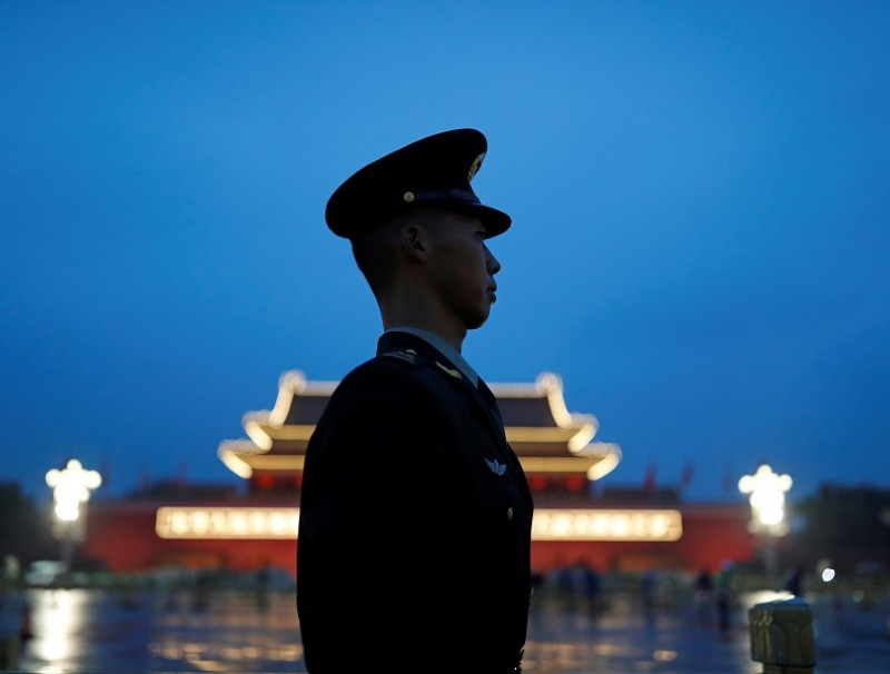 A paramilitary police officer stands guard during a flag-raising ceremony at Tiananmen Square on National Day to mark the 71st anniversary of the founding of People's Republic of China, in Beijing, China, 1 October 2020. (Carlos Garcia Rawlins/Reuters)