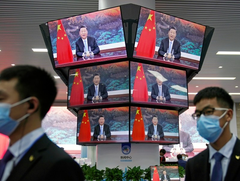 Chinese President Xi Jinping is seen on screens in the media center as he speaks at the opening ceremony of the third China International Import Expo (CIIE) in Shanghai, China, 4 November 2020. (Aly Song/Reuters)