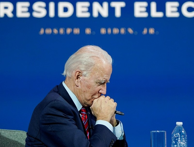 US President-elect Joe Biden listens as he holds a video conference meeting with members of the US Conference of Mayors at his transition headquarters in Wilmington, Delaware, US, 23 November 2020. (Joshua Roberts/Reuters)