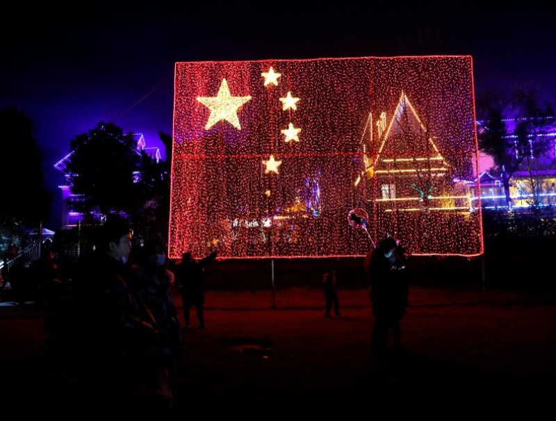 A giant Chinese national flag comprised of light bulbs is seen during a celebration event on New Year's Day, amid the coronavirus disease (COVID-19) outbreak, at a park in Wuhan, Hubei province, China, 1 January 2021. (Tingshu Wang/REUTERS)