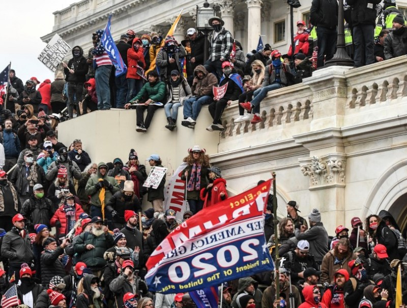 "Supporters of U.S. President Donald Trump gather at the west entrance of the Capitol during a ""Stop the Steal"" protest outside of the Capitol building in Washington D.C., 6 January 2021. (Stephanie Keith/REUTERS)"