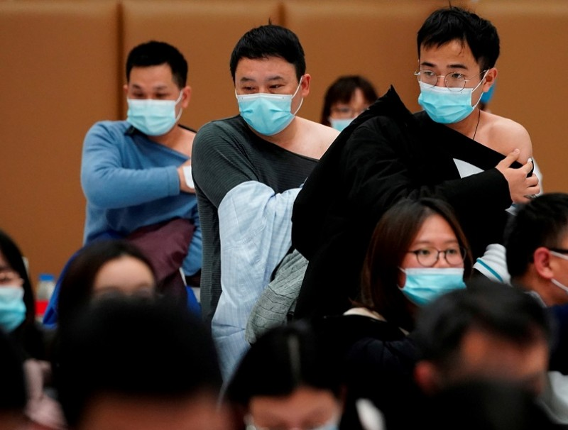 People stand at a vaccination site after receiving a dose of the Covid-19 vaccine, in Shanghai, China, 19 January 2021. (Aly Song/File Photo/Reuters)