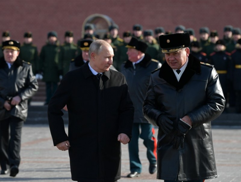 Russia's President Vladimir Putin and Defence Minister Sergei Shoigu attend a wreath-laying ceremony at the Tomb of the Unknown Soldier by the Kremlin Wall to mark the Defender of the Fatherland Day in Moscow, Russia, 23 February 2021. (Sputnik/Alexei Druzhinin/Kremlin via Reuters)