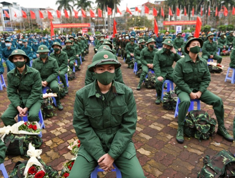 Vietnamese military new recruits at a ceremony before leaving for military service, in Hanoi, Vietnam, 27 February 2021. (Thanh Hue/Reuters)