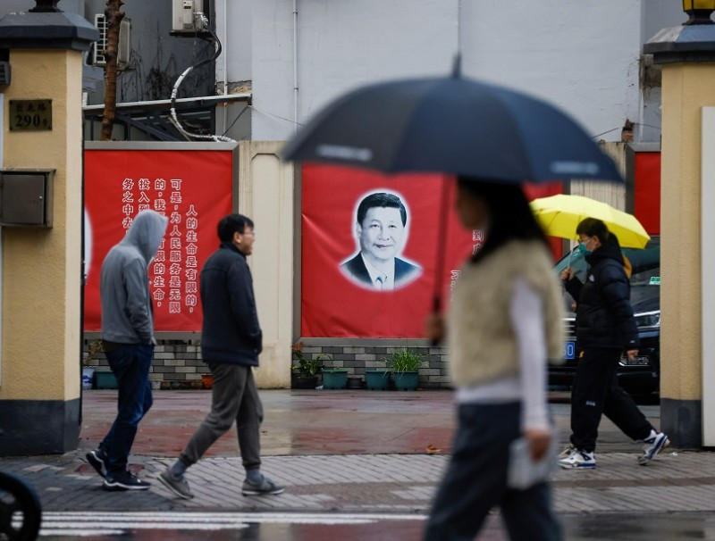 A picture of Chinese President Xi Jinping overlooks a street ahead of the National People's Congress (NPC), in Shanghai, China, 1 March 2021. (Aly Song/Reuters)