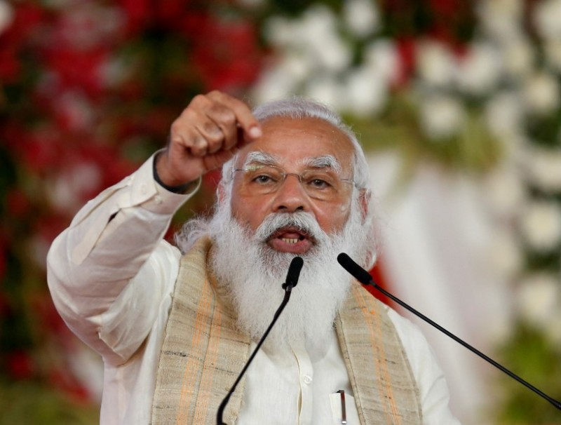 "India's Prime Minister Narendra Modi addresses a gathering before flagging off the ""Dandi March"" or Salt March, to celebrate the 75th anniversary of India's Independence, in Ahmedabad, India, 12 March 2021. (Amit Dave/Reuters)"