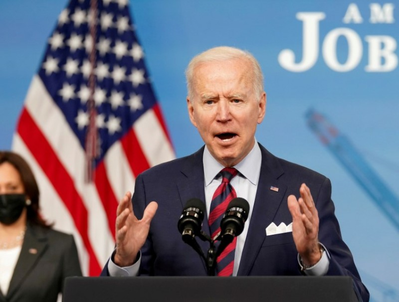 US President Joe Biden speaks about jobs and the economy at the White House in Washington, US, 7 April 2021. (Kevin Lamarque/Reuters)