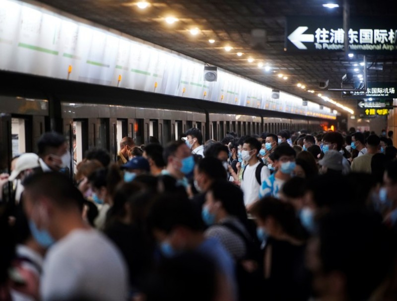 People at a subway station in Shanghai, China, 11 May 2021. (Aly Song/Reuters)