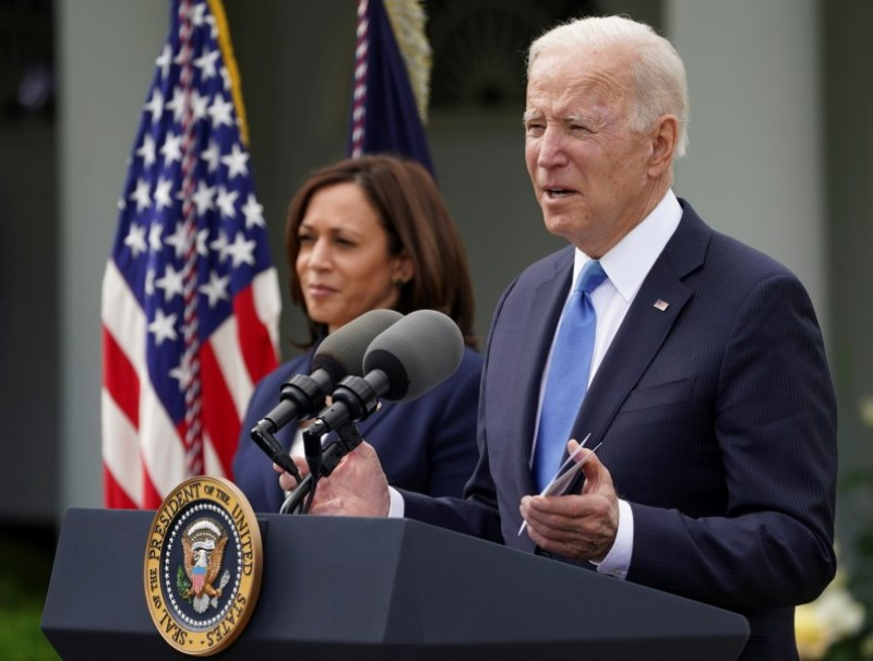 U.S. President Joe Biden, accompanied by Vice President Kamala Harris, speaks at the Rose Garden of the White House in Washington, U.S., 13 May 2021. (Kevin Lamarque/Reuters)