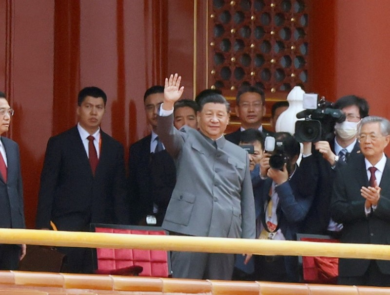 Chinese President Xi Jinping waves at the end of the event marking the 100th founding anniversary of the Communist Party of China, on Tiananmen Square in Beijing, China, 1 July 2021. (Carlos Garcia Rawlins/Reuters)