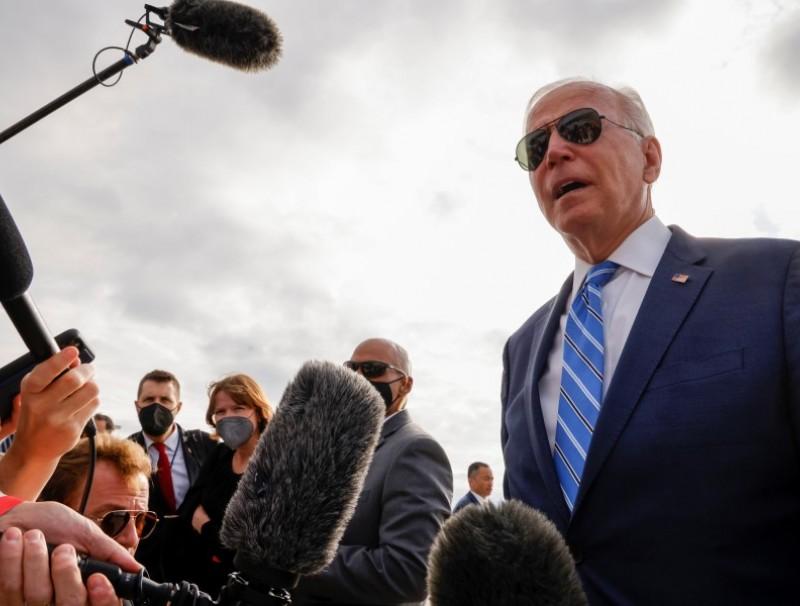 US President Joe Biden speaks to reporters before boarding Air Force One to depart Capital Region International Airport in Lansing, Michigan, US, 5 October 2021. (Jonathan Ernst/Reuters)