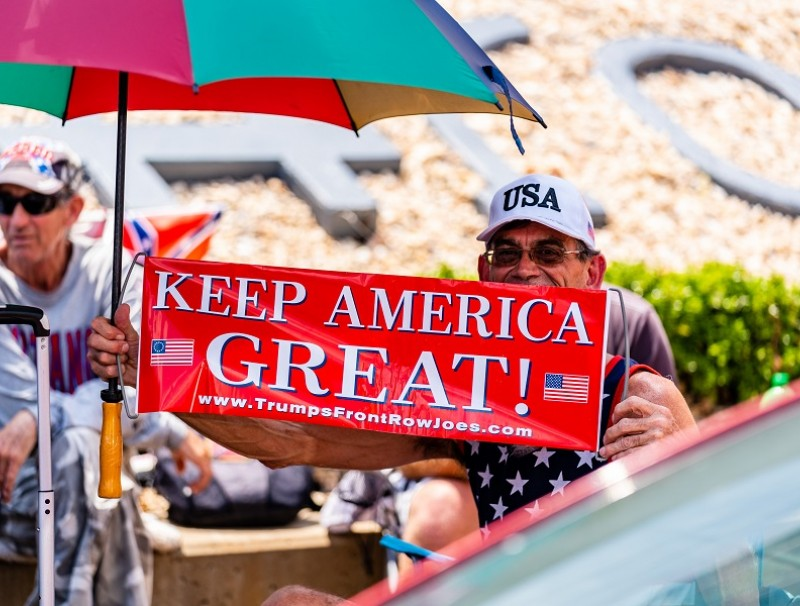 """A person holds a sign that reads """"Keep America Great!"""" outside of the BOK Center ahead of a rally for US President Donald Trump in Tulsa, Oklahoma, US, on 17 June 2020. (Christopher Creese/Bloomberg)"""