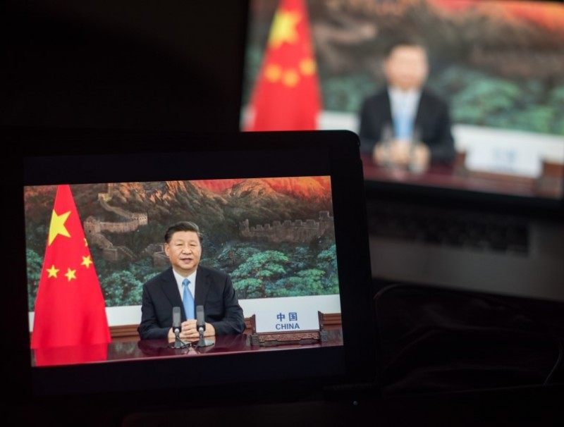 """Xi Jinping, China's president, speaks during the United Nations General Assembly seen on a laptop computer in Hastings on the Hudson, New York, US, on 22 September 2020. President Xi Jinping took a veiled swipe at the U.S. in a strongly worded speech, saying no country should """"be allowed to do whatever it likes and be the hegemon, bully or boss of the world."""" (Tiffany Hagler-Geard/Bloomberg)"""