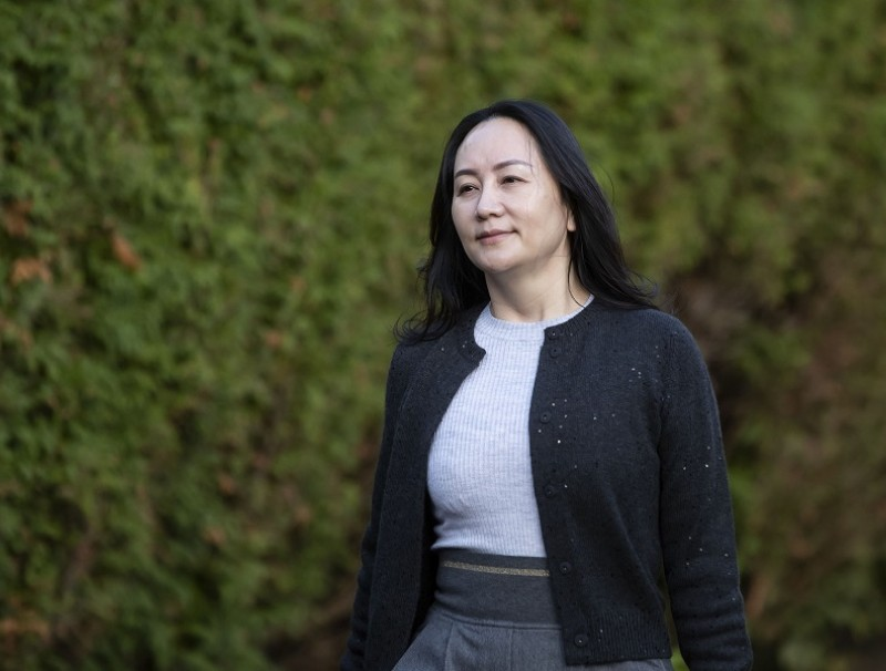 Huawei CFO Meng Wanzhou leaves her home to appear in Supreme Court for a hearing in Vancouver, British Columbia, Canada, 26 October 2020. (Darryl Dyck/Bloomberg)