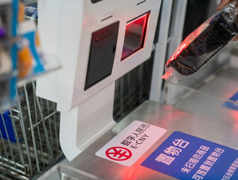 Signage for the digital yuan, also referred to as E-CNY, at a self check-out counter inside a supermarket in Shenzhen, China, on 20 November 2020. (Yan Cong/Bloomberg)