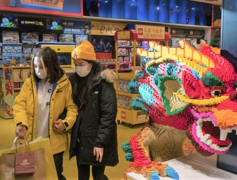 Customers walk past a dragon made from Lego bricks at a store in Beijing, China, on 7 December 2020. (Gilles Sabrie/Bloomberg)