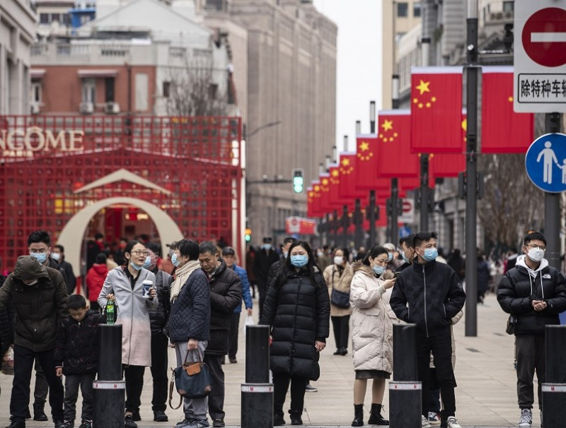 Pedestrians walk down Nanjing Road in Shanghai, China, on 12 February 2021. (Qilai Shen/Bloomberg)