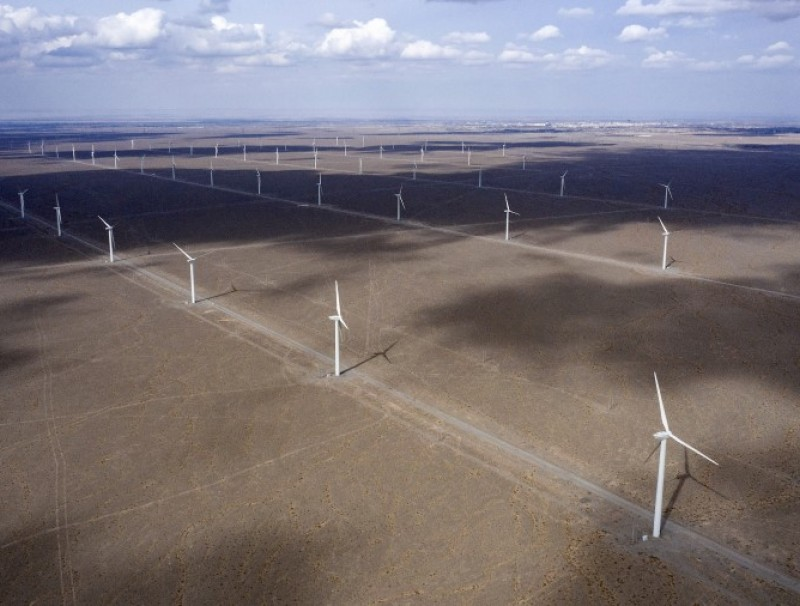 Wind turbines on the outskirts of the new city area of Yumen, Gansu province,China on 31 March 2021. (Qilai Shen/Bloomberg)