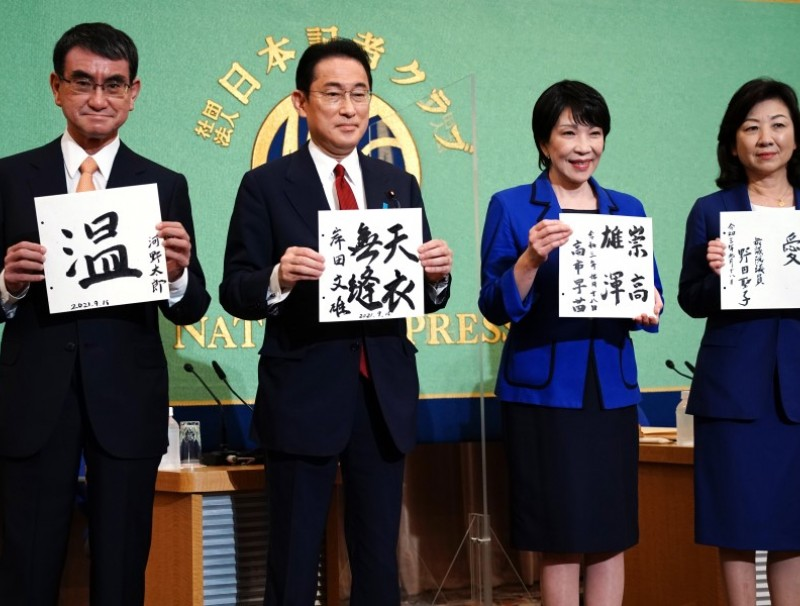 (From left) Taro Kono, Fumio Kishida, Sanae Takaichi and Seiko Noda hold papers with their mottos before a debate ahead of the Liberal Democratic Party (LDP)'s presidential election at the Japan National Press Club in Tokyo, Japan, on 18 September 2021. (Eugene Hoshiko/Bloomberg)